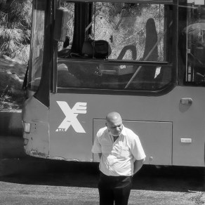 Driver stands at attention on Yom HaZikaron 2020 as commeoprative sirens blow