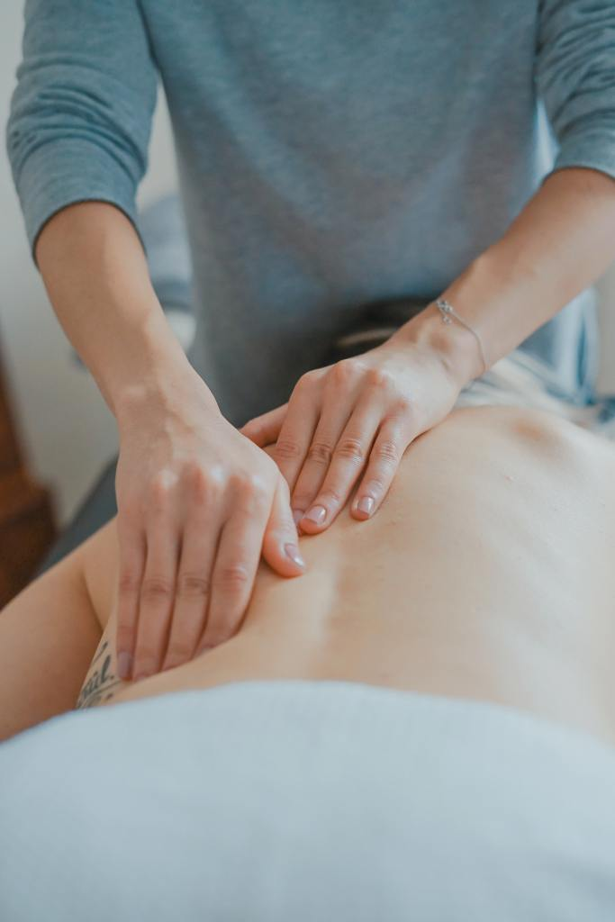 Physical Therapist rubbing a person's back