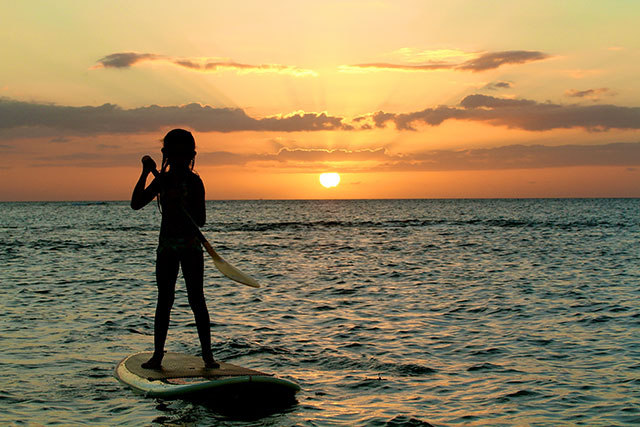 Eric Keawekane: Always fearless and full of smiles as she follows her father's lead is my beautiful niece, Anuhea. Here she SUP's capturing the last light and colors at the commencement of a warm Hawaiian Evening. Go girl!