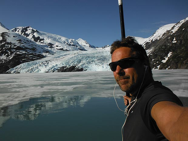 """Karl Mittelstadt: Portage Glacier early spring glass smooth no wind early morning wake up & live Paddle on my 12'6"""" Nash Glide still a layer of Ice in front of Glacier RESPECT ALASKA Portage Lake is 800ft deep... Selfie - Karl Mittelstadt"""