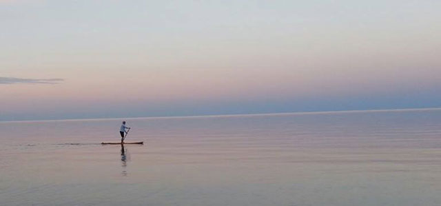 """Kathryn Lassila: A beautiful day for paddling on Lake Superior near Gay, Michigan. Kathryn Lassila and her family stay at her husband's family cabin in Hermit's Cove. Such a calm day on """"the big lake"""" is kind of a rarity."""
