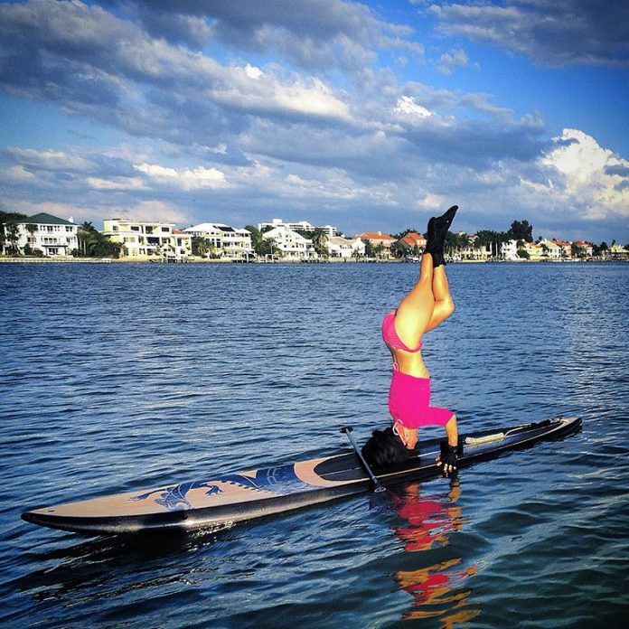 May Ho: Life is a balancing act. My constant practice of standup paddling and yoga to attain focus, balance and core strength here in St.Petersburg Fl.