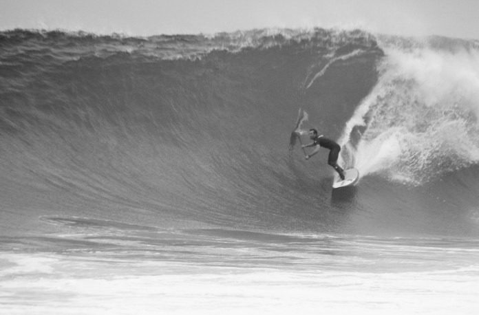 Brennan Rose stand up paddle surfing the wedge RIGHT