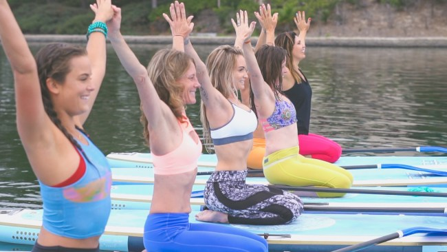 Kelly Huck SoCal SUP Yoga Starboard hands held