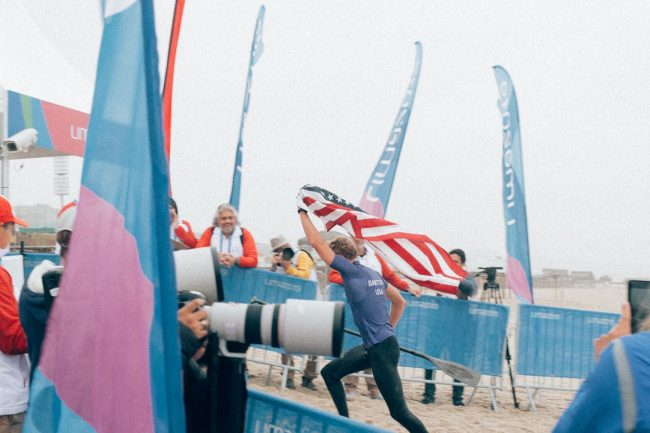 Connor Baxter Peru victory with flag Pan American Games