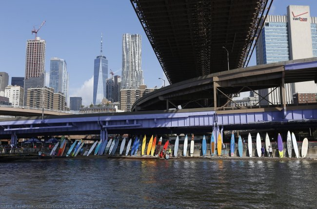 SEA Paddle NYC boards under Brooklyn Bridge mark costa