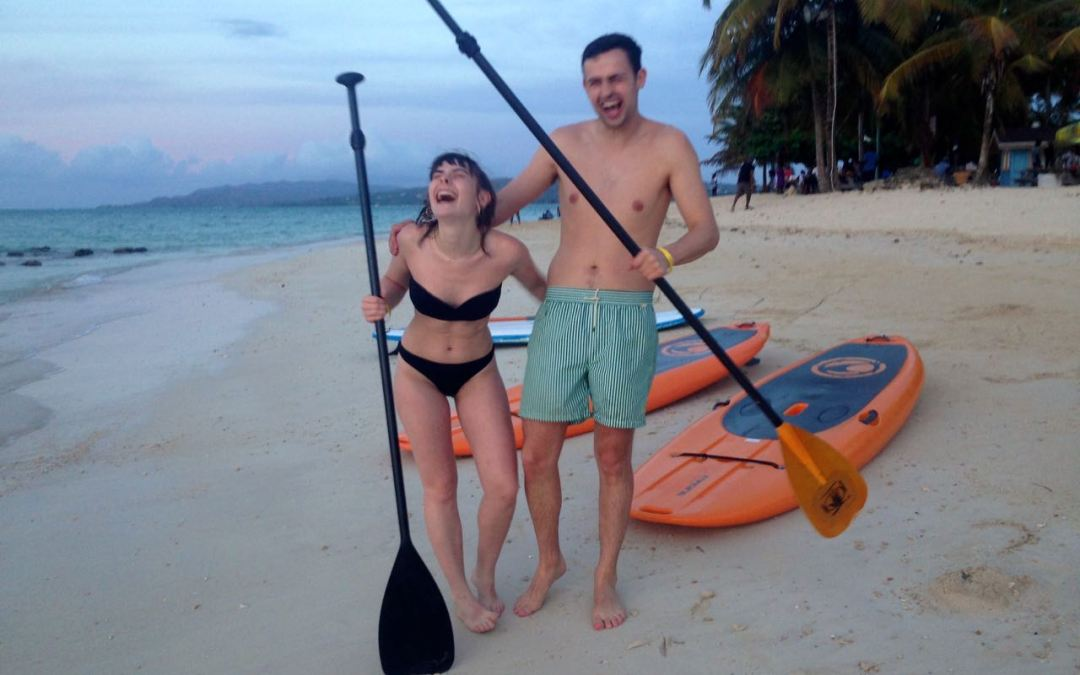 Smiling with Stand Up Paddle Tobago
