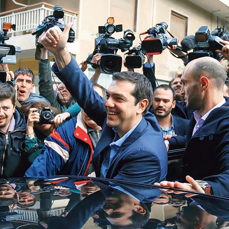 Опозициони лидер Алексис Ципрас прославља победу (Фото: Ројтерс)