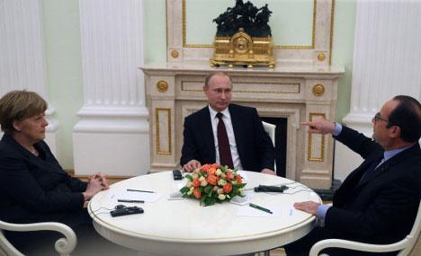 Немачка канцеларка Ангела Меркел и председник Француске Франсоа Оланд најавили су своју посету Кремљу само дан унапред. Извор: Росијска газета