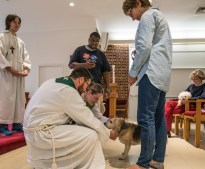 2016 Blessing of the Animals: James and Nancy bless Julie's dog