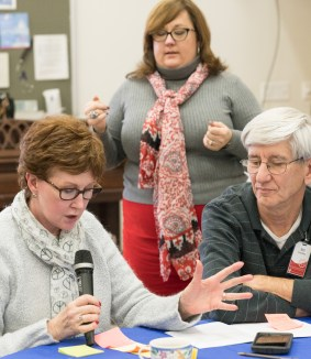 Search committee member Donna Cowden, Canon Catherine Massey (standing), and Bill Cowden