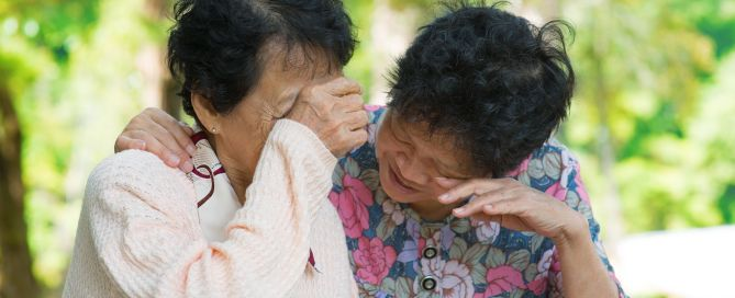 sad senior asian women in outdoor park.