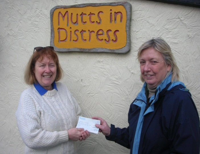 Cllr Susan Barker, Chairman of Stansted Airport Community Trust (SACT) presenting the grant cheque to Pat Clark, founder of Mutts in Distress Rescue