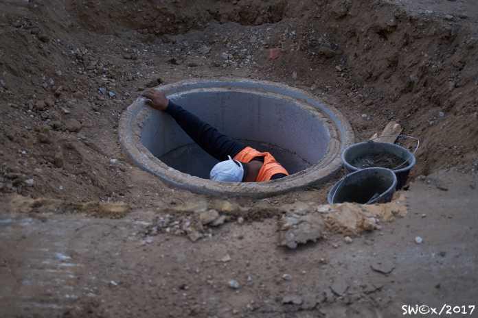 Man in manhole