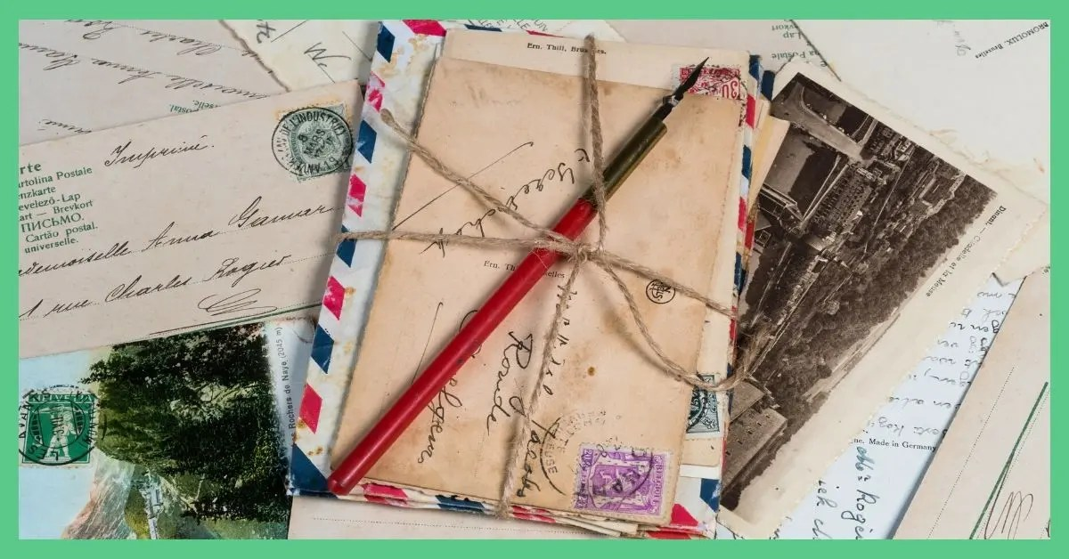 The image shows a pile of postcards and letters. The postcards are batched together with twine tied around them. The image has a green border around it.