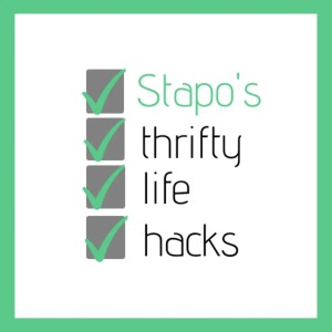 The image shows the Stapo's Thrifty Life Hacks logo. The name of the brand is listed out and before each word there is a green tick in a grey box. The logo has a green frame around it.