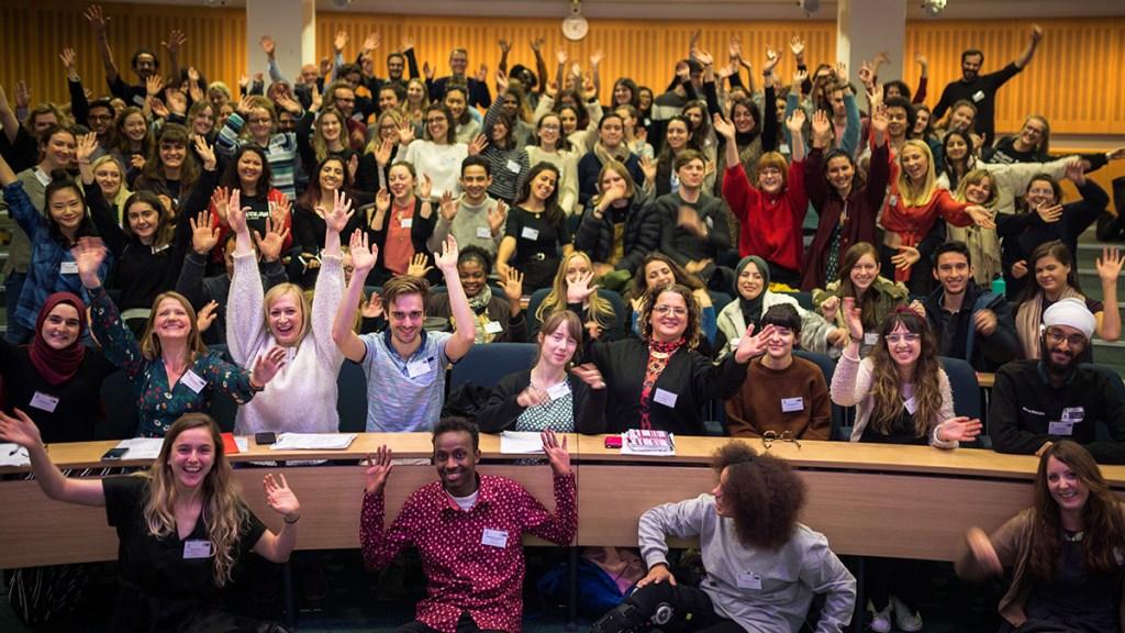 Delegates wave at a STAR conference