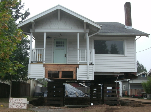 A home in the Rose City Park Neighborhood raised on blocks so its foundation can be renovated demonstrates a rebuilding trend spurred by almost a decade of economic caution, according  to local contractor Kevin Pasion, who said his firm and others are seeing more jobs as the economy  improves.