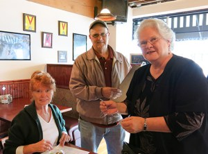 Jan Tolman of Jan And . . . Hair Design for Men & Women, Paul Clark of Township Properties, and Linda Seals of POSH design (now on-line), discuss business strategies at the Hollywood Boosters meeting held at the Columbia River Brewing Company on Northeast 40th Avenue.