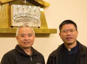 Parish chairman Francis Pham and Pastor Rev. Bartholomew Pham Huu Dat stand inside Our Lady of LaVang church, the only Vietnamese Catholic church in Oregon.