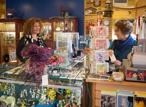 Customer Barb Hamilton, left, enjoys shopping for unique gifts at Trade Roots on Northeast Broadway. Tamara Patrick, one of the store's owners, said about 80 percent of the customers come from the neighborhood to shop at Trade Roots which celebrated 25 years in business.