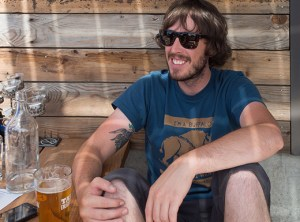 Alex Berry rides his bike from Boise-Eliot neighborhood to enjoy a cold one at Bushwhacker's Cider Mill, on Northeast Oneonta, part of The Woodlawn, a mixed-use apartment building in Woodlawn.
