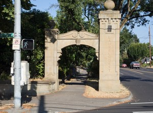 One of a pair of sandstone Laurelhurst arches at Northeast Burnside and 32nd Street were built in 1909 to welcome visitors to the neighborhood. Through donations from the annual Laurelhurst garage sale, volunteers plan to restore lighting to the arches.