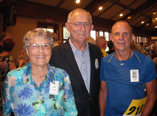 Longtime Grant coach and teacher Mark Cotton, center, with his wife Jane and Class of 1965 student Ken Zell. (Chip Kessler)