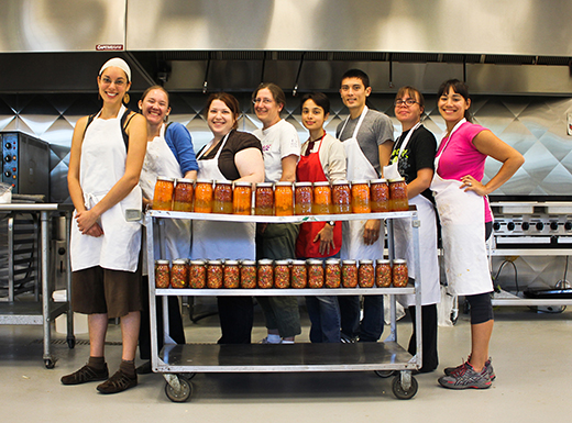 The Kitchen Commons community canning group shows off the bounty of their efforts. Kitchen Commons is a non-profit group that organizes opportunities for people to cook, eat and converse with each other. (Kitchen Commons)