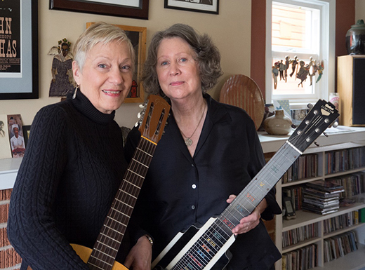 293. (left to right) Rebecca Kilgore, local jazz vocalist who also plays classic guitar, joins Mary Flower holding her square-necked lap slide guitar. Kilgore admires Flower's skill as well as her warmth and confidence. Flower describes Kilgore as a brilliant song finder and interpreter. (Judy Nelson)