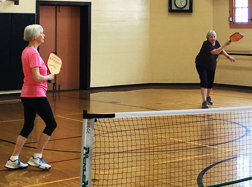Linda Tester, left, and Sharon Beckett play Pickleball at the Northeast Community Center. (Northeast Community Center)
