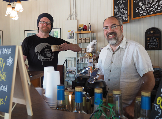 Christopher Ruppert of TigerLily Tattoo, drops by Wholesome Blends for his morning coffee. Scott Graham opened the coffee shop in 2002 and advocates for re-purposing former gas stations like this one on Northeast Sandy Boulevard. (Judy Nelson)
