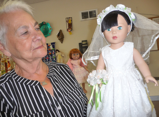Doris Heaton, a former bridal shop owner, continues to make wedding finery for dolls. She also makes outfits for America Girl dolls, including pants suits. She starts with a pattern then modifies it to suit her creative eye. (Janet Goetze)