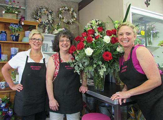 On September 1, Pattie Scarpelli, left, will hang up her apron as owner of Beaumont Florist and longtime employee Amy Walling, center, will become the new owner of the neighborhood floral shop. (Ted Perkins)