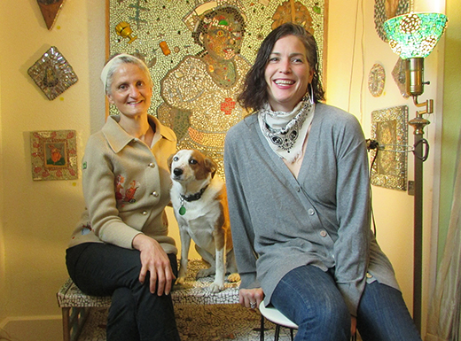 Cully neighborhood artist Mary Tapogna, left, has opened a seasonal, retail space called Hail Mary Poppe Up Shoppe inside of Eric Bohne and Roxanne Mautino's, right,5 Metalwood Salvage. (Jane Perkins)