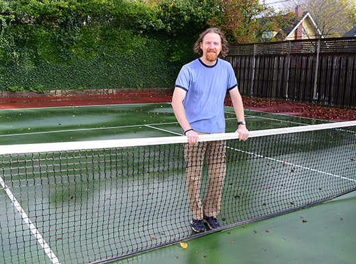"Irvington resident, photographer Soren Coughlin-Glaser plays tennis on the outside court at Irvington Club. He noted that the television show, ""Grimm,"" has frequently filmed at homes nearby and at the Club's pool."