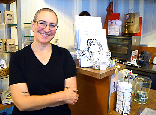 "Dawn Furstenberg stands next to a display of her first adult coloring book, ""She Found herself in a Cup of Coffee"" at Wholesome Blends on Northeast Sandy Boulevard. (John Butenschoen)"