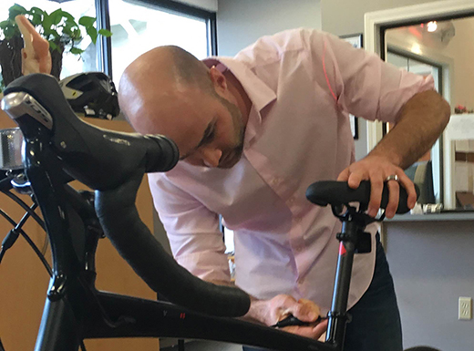 Broadway Physical Therapy's Matt Flood fits bikes to riders