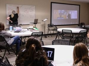 Teacher teaching hybrid course in the classroom