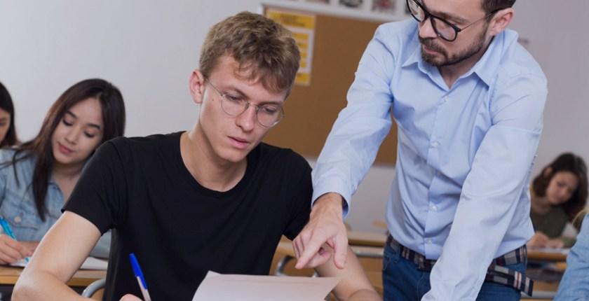 teacher helpinf student in class