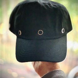 The Moon Hat - Baseball Cap Style shown in front view hand held Moon Phases New Moon and Crescent Moon