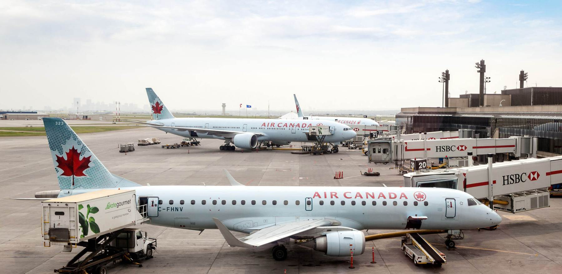 CALGARY, CANADA - JULY 18: Air Canada commercial planes on the tarmac of Calgary International Airport July 18, 2014. Opened in 1938, the airport offers non-stop flights to major cities in North America, Europe and East Asia.