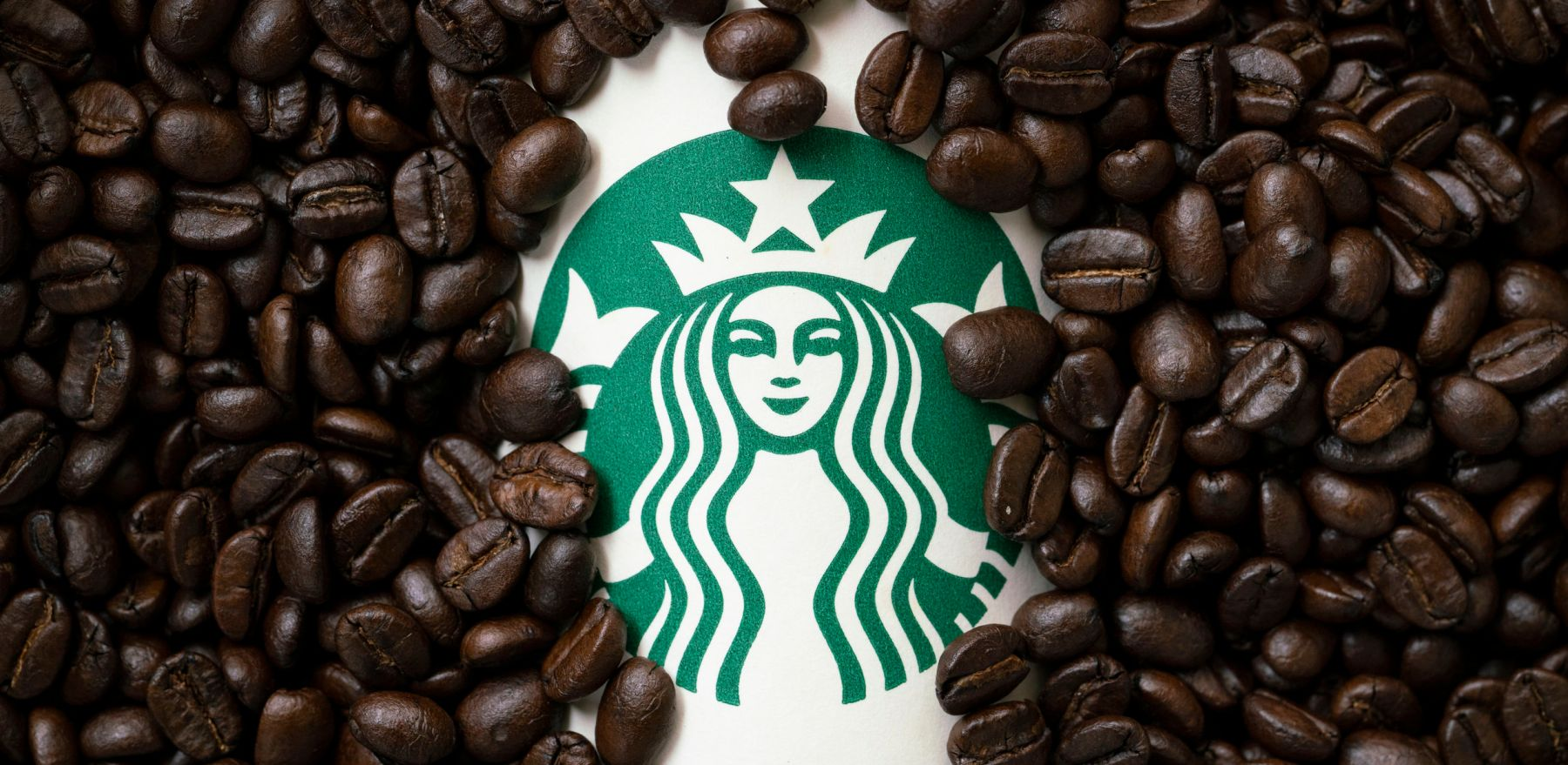 Bangkok, Thailand - Aug 26, 2018: A cup of Starbuck coffee with coffee beans background