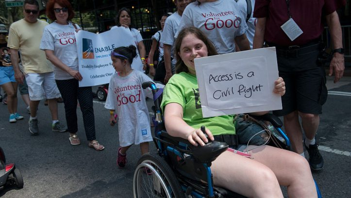 People participate in the first annual Disability Pride Parade on July 12, 2015, in New York City. The parade calls attention to the rights of people with disabilities and coincides with the 25th anniversary of the Americans with Disabilities Act. (Stephanie Keith/Getty Images)