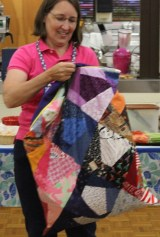 Kathy Wickham - Pillowcase constructed with crazy quilt blocks