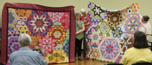 Diana Van Hise and Bonnie Blessing with their Millefiore quilts - same pattern, very different quilts!