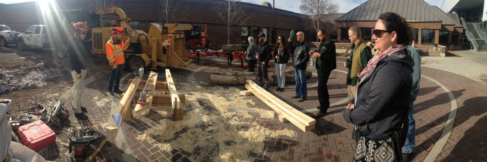 Attendees enjoy an urban lumber milling and timber frame construction demonstration outside