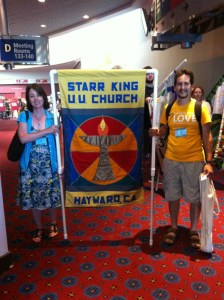 Sandy and Bob Simoni with SKUUC banner, General Assembly 2015