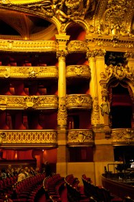 inside the actual theater area - gorgeous red velvet seats and ornate golden decorations on the balcony. beautiful and showy!