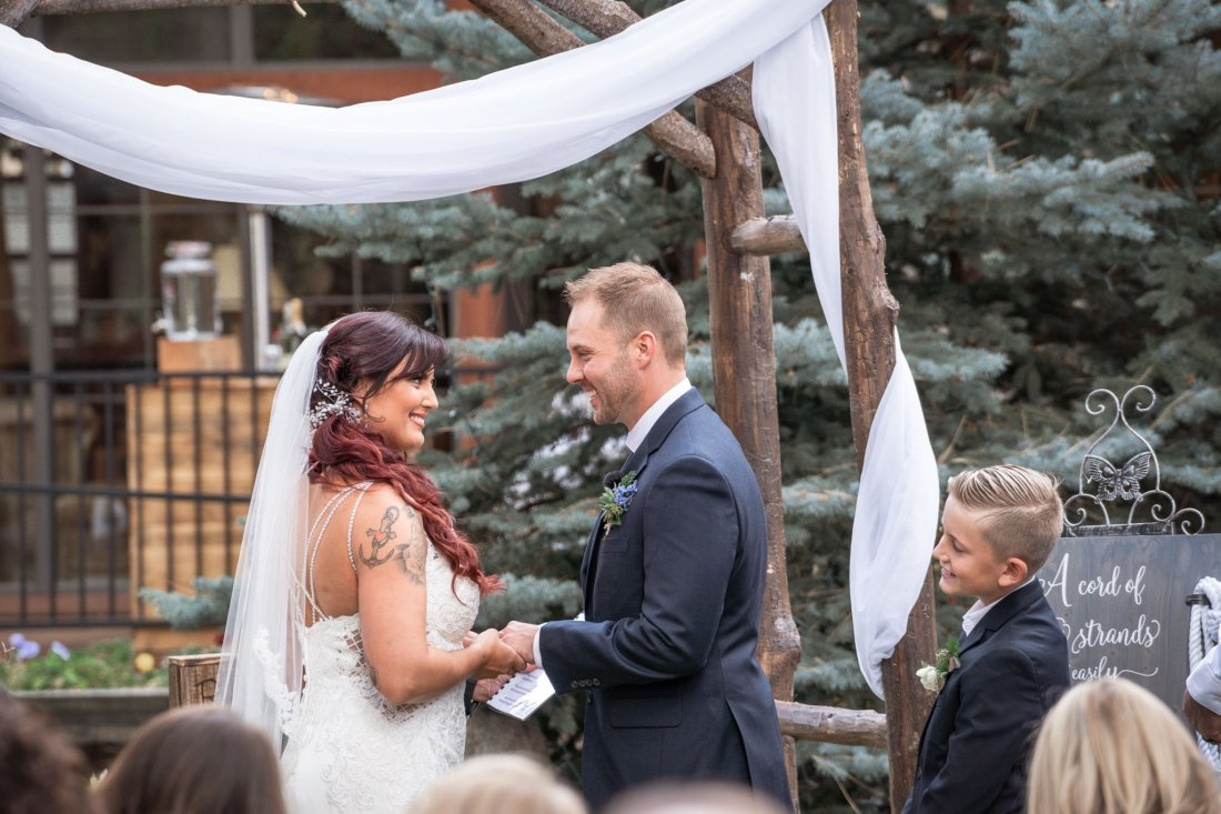 Bride, groom, and young son say their collective vows to become a family
